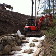 Re-aligning drainage line in bushland