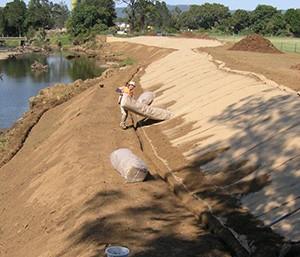 installing jute along river